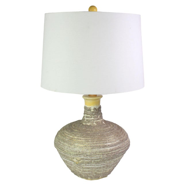 1970's oversized hand thrown studio pottery lamp with a canary yellow glaze and unique texturization throughout....
