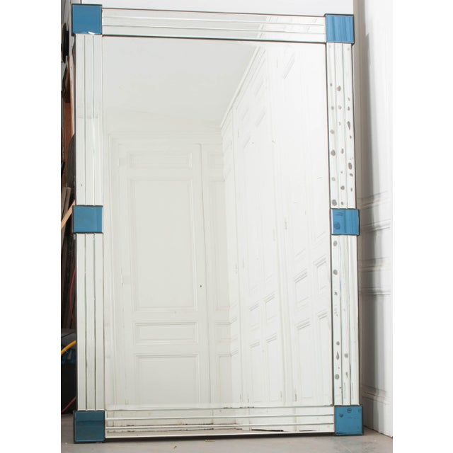This fabulous Art Deco beveled mirror is from 1920's France and not only has a tri-beveled mirror frame, it has been...