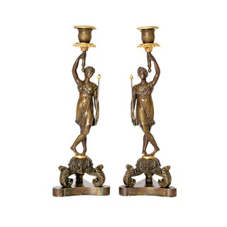 A Pair of French Bronze and Bronze Gilt Candlesticks For Sale