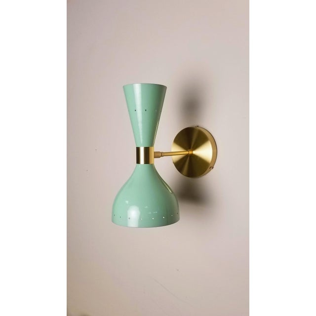 "Our best-selling LUDO wall sconce or reading light shown in natural brass and our lovely ""Sweet Mint"" light blue green..."