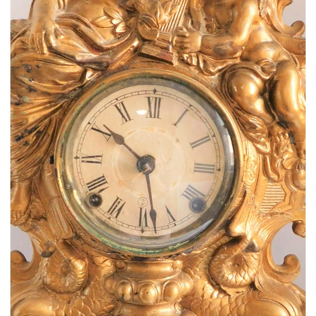 This unique and wonderful 19th century Victorian Gilt metal table clock is such a striking piece! Speaking of striking, it...