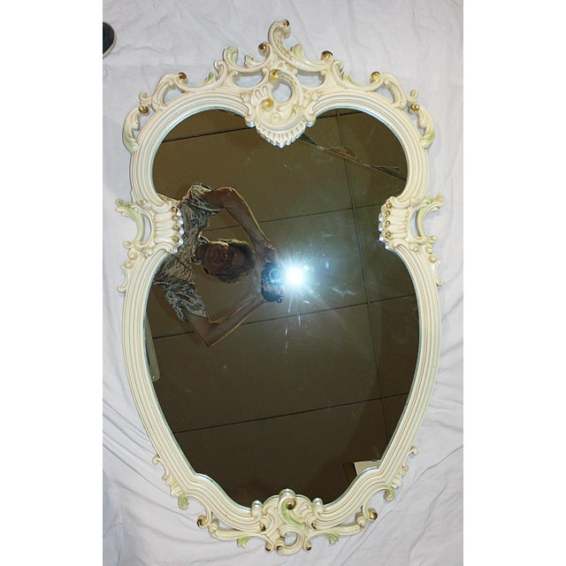Offered is a solid 1980s cast resin French rococo mirror with wisps of lime and deep bronze touches. Union City Mirror Co...