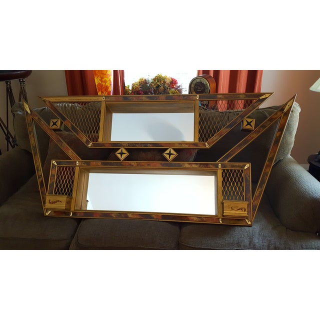 This 1950s mirrored shadowbox has a life all its own. It features a gold-and-bronze splattered wood frame with diamond...