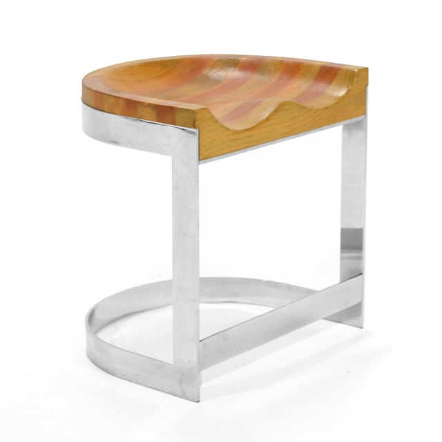 This beautiful design by Warren Bacon rocks! It combines a thick sculpted oak seat with a polished chrome steel base. The...