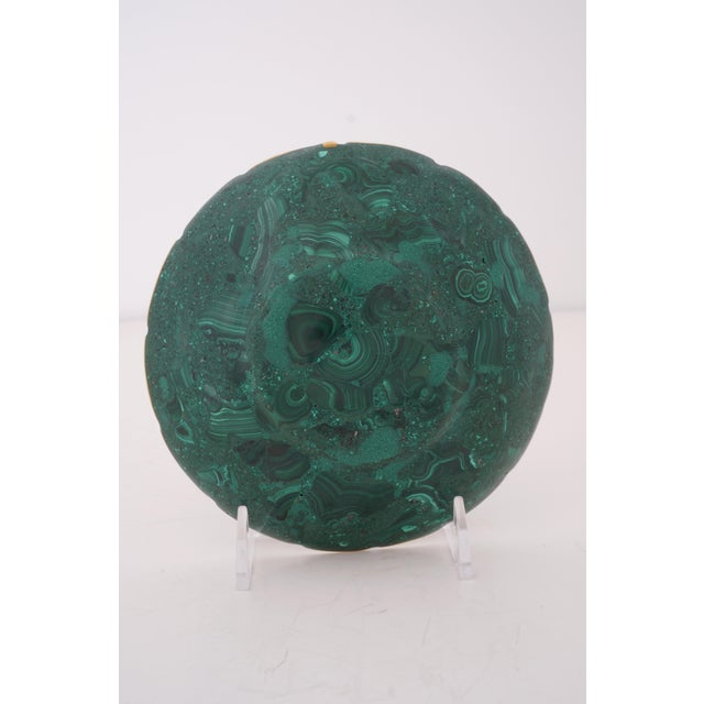 Vintage Round Malachite Dish With Scalloped Brass Rim from a Palm Beach estate. We have several of these available as well...