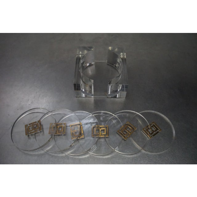 From the personal collection of Shay Mitchell. Great set of six Tory Burch logo coasters with holder. Whose better at...