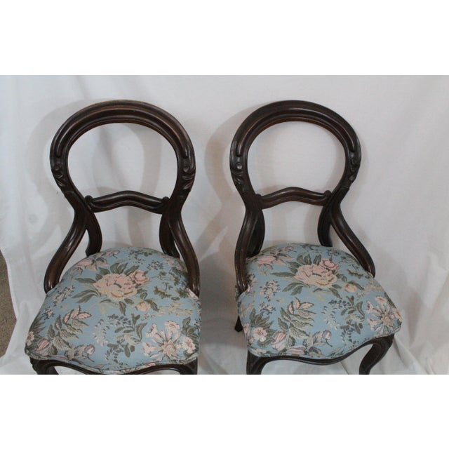 These two antique Edwardian/Victorian balloon backed accent chairs have been reupholstered in light blue with a lovely...