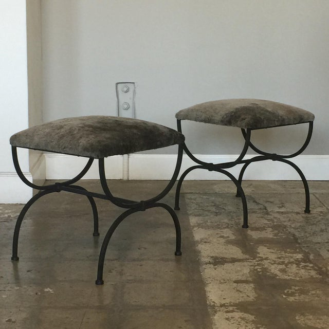 Pair of chic gray shearling 'Strapontin' stools by Design Frères. Matte black steel base with grey shearling upholstered...