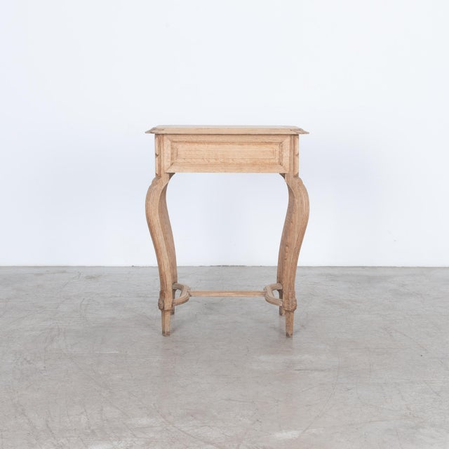Convenient small table with hinged top and inset mirror. Constructed from oak with a natural oil finish, this piece...