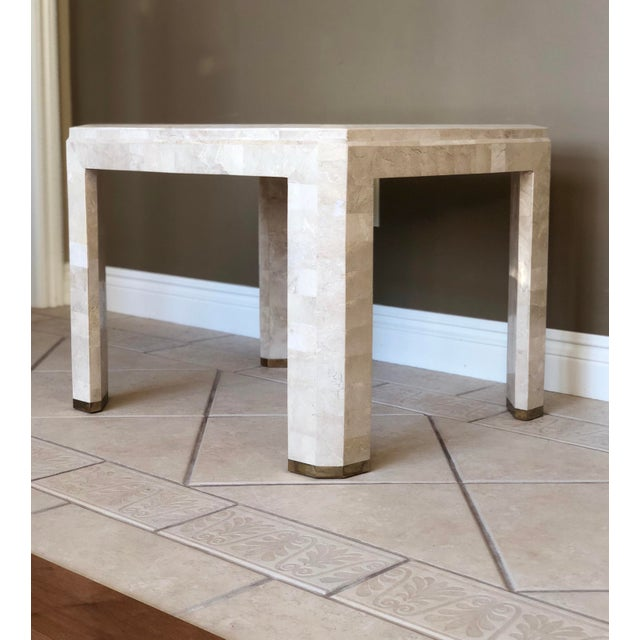 For your consideration is a sleek Mid-Century tessellated stone side table. This elegant piece is in very good condition....