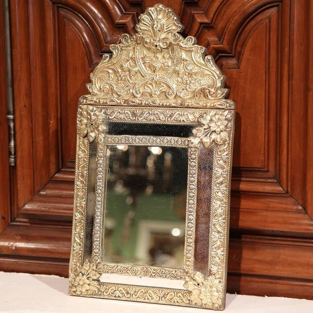 This small, elegant Napoleon III copper mirror was crafted in France, circa 1860. The antique wall hanging repousse piece...