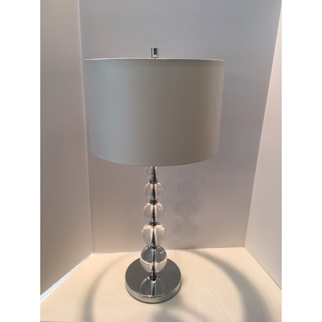 """Contemporary and sleek crystal lamp on chrome base with two pull chain sockets. 23"""" to socket. Some surface scuffing on..."""