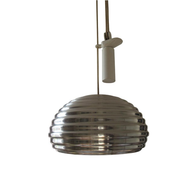 Rare Achille Castiglioni Splügen Brau counterweighted Pendant Light. Edited by Flos, polished aluminum and lacquered...