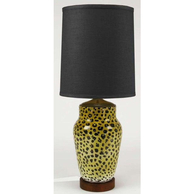 Large ginger jar shaped ceramic table lamp in leopard pattern hand glazing. Walnut wood base and patinated brass cap with...
