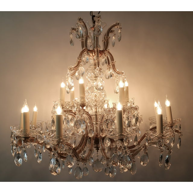 Circa 1900 Graceful & elegant Austrian Maria Theresa Crystal Chandelier features 2 tiers totaling 18 lites. Completely...