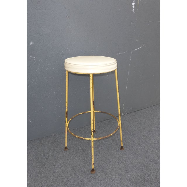 A vintage, yellow metal and white vinyl bar stool. This is a great looking, industrial bar stool. The paint is in rustic...