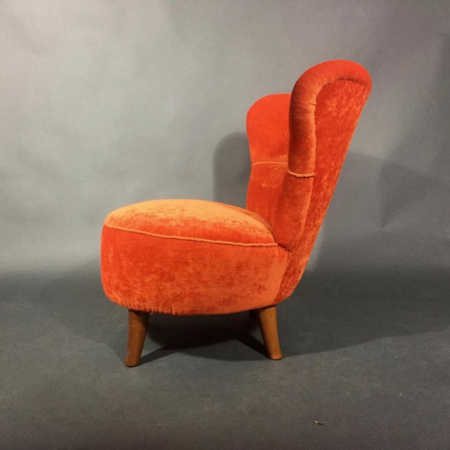 The chair is ascribed to Bernströms Industry Möbler in Sweden from the 1950s, though the current orange velvet is newer...