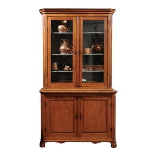 Dutch 1900s Oak Bookcase with Glass Doors, Rocaille Motifs and Canted Side Posts For Sale