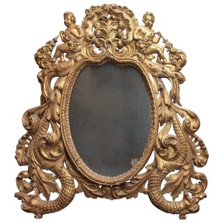 Pierced Giltwood Mirror With Putti and Sea Creatures For Sale
