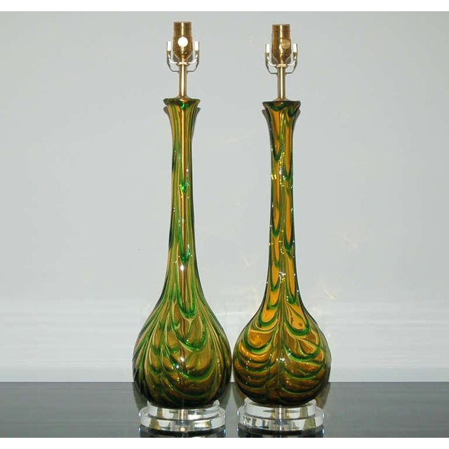 Pulled feather design of EMERALD GREEN applied glass draped over hand blown BUTTERSCOTCH glass. A simple design with eye-...