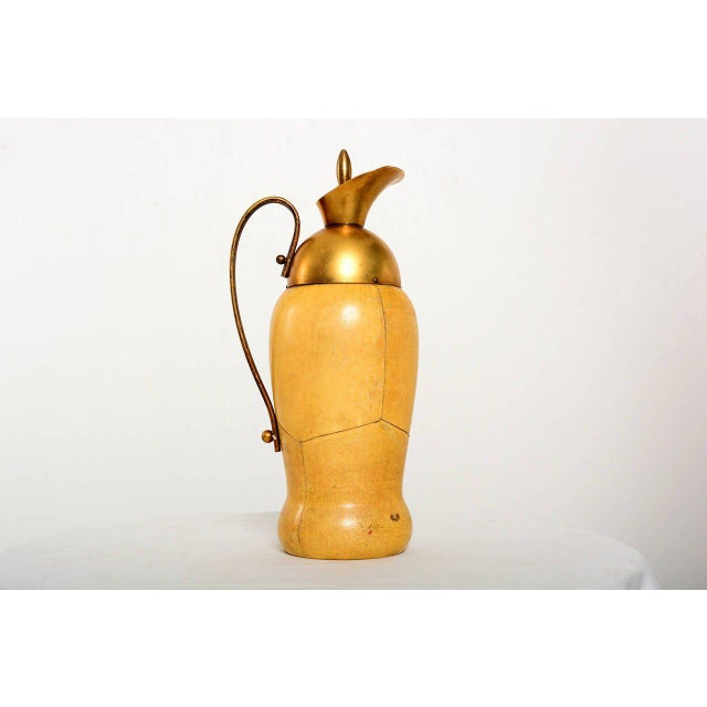 For your consideration a vintage pitcher by Aldo Tura. Constructed with sculptural wood body wrapped in parchment. Solid...