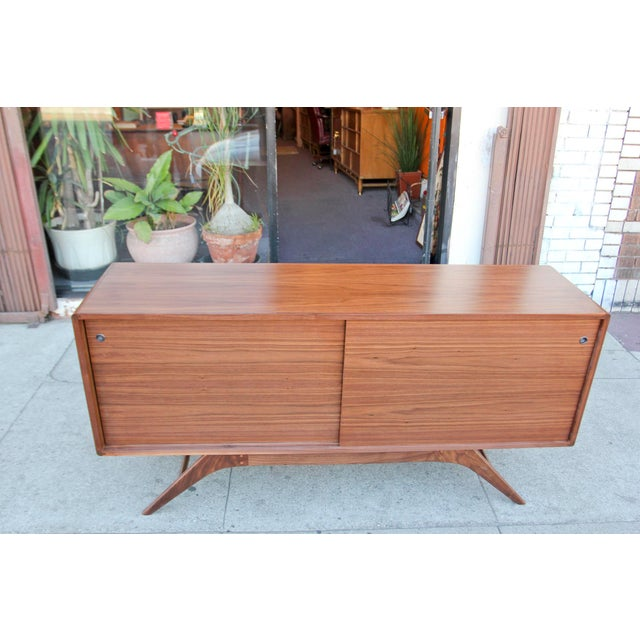 Absolutely beautiful, mid-century style walnut credenza hand made in Los Angeles. The base is solid American walnut and we...