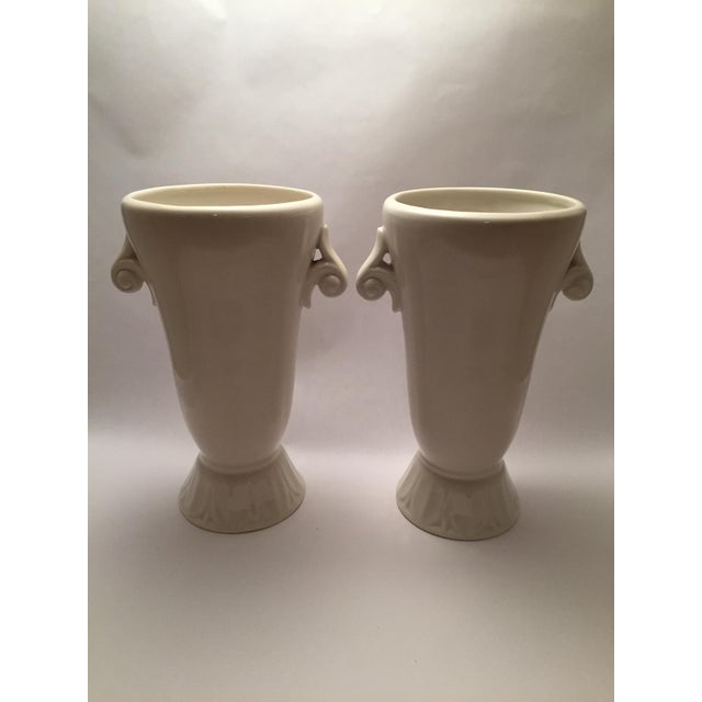 Great pair of vases for accessorizing or flowers. Marked, one vase also bears a partial paper label.