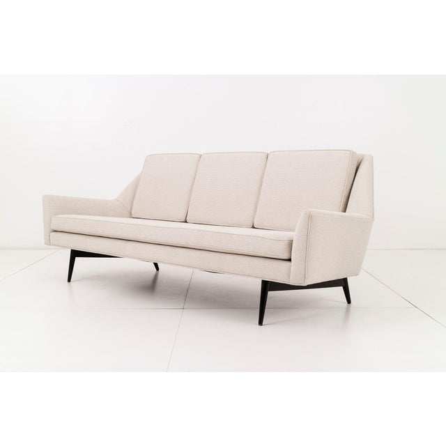 Rare geometric sofa by Paul McCobb for Custom Craft Inc. Upholstered in Holly Hunt woven fabric. Solid turned tapered...