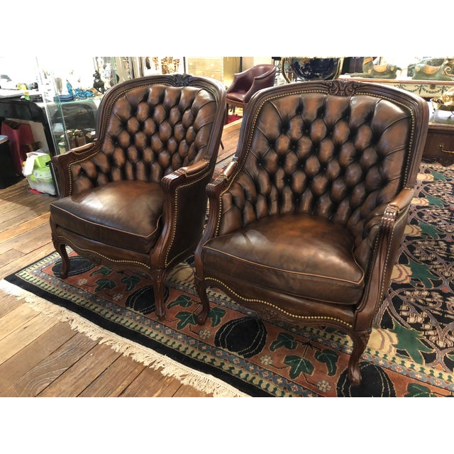 Two drop dead gorgeous impressive tufted leather barrel shaped curved club chairs having an unusual burnished coppery...