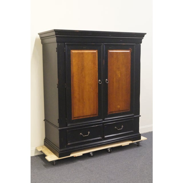 "Hooker Furniture 64"" armoire. We specialize in high end used furniture that we consider to be at least an 8 on a scale of..."