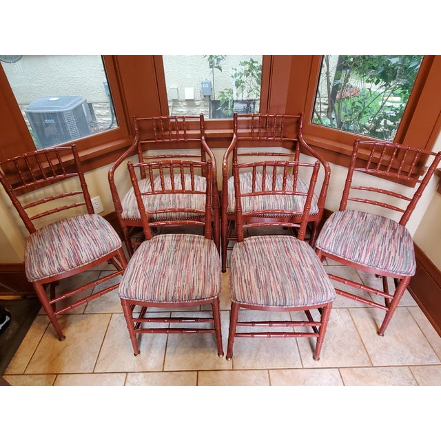 Set of 6 mid-century faux bamboo Hollywood Regency dining chairs. 2 arm chairs and 4 side chairs - finish is dark red with...