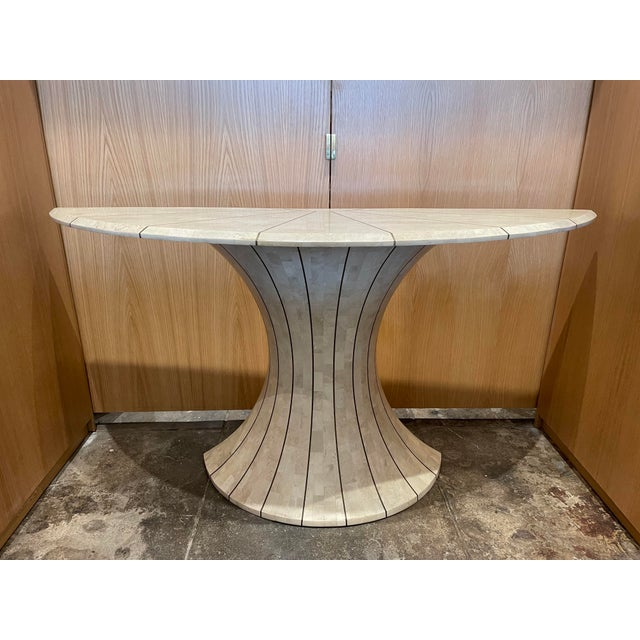 Vintage Maitland Smith tessellated travertine and brass inlay demilune console table. This stunning 1970s table is elegant...