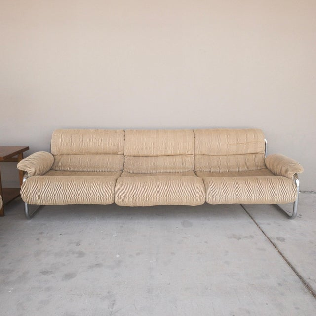 Groovy vintage sling sofa hailing from the 1970's! Matching loveseat also available on our Chairish!