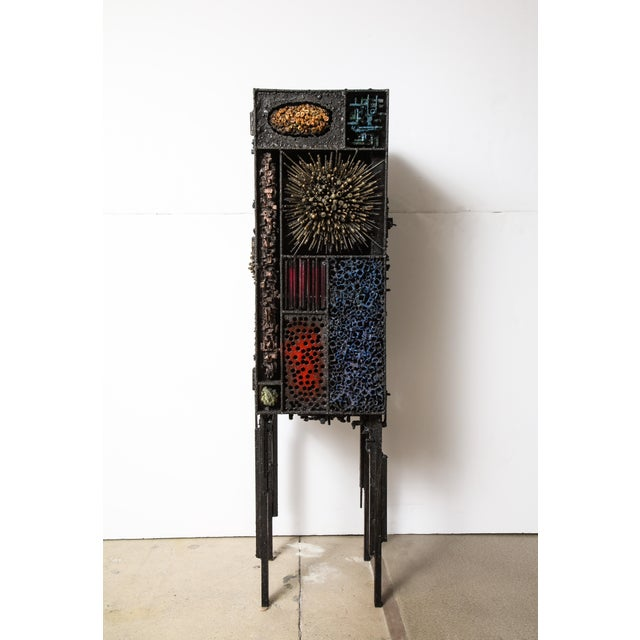 """""""Segment Cabinet,"""" a dynamic brutalist work in textured, polychromed and bronzed steel by Des Moines, Iowa artist James..."""