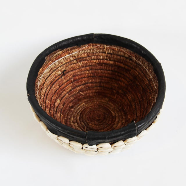 Vintage Nigerian handmade cowry shell basket. Cowry shells are an African symbol of wealth. They are used for trade and...