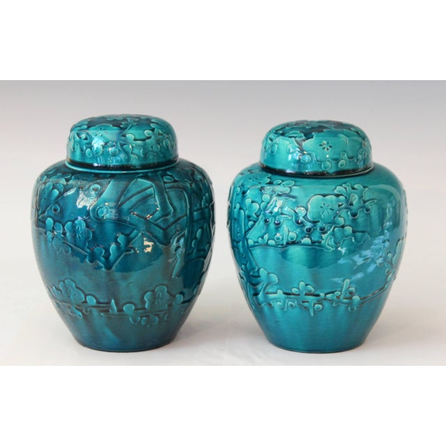 Pair of Awaji ginger jars and covers decorated with applied and incised prunus blossoms highlighted with a deep turquoise...