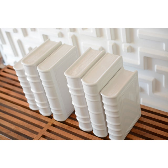 This listing is for a set of 6 total, post-modern white ceramic book sculptures. There are two sizes. Great for a built-in...