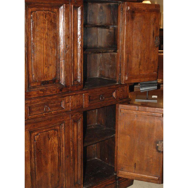 A Vintage Italian elm cabinet having hidden compartments, comprised of antique elements.