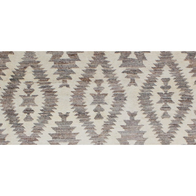 Hand knotted of top quality natural dyed wool and cotton in Afghanistan. This unique and innovative Navajo style Rug is an...