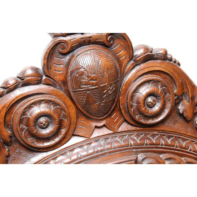 Italian, carved oak mirror, with crest and coronet. C.1870. Extensive carving.