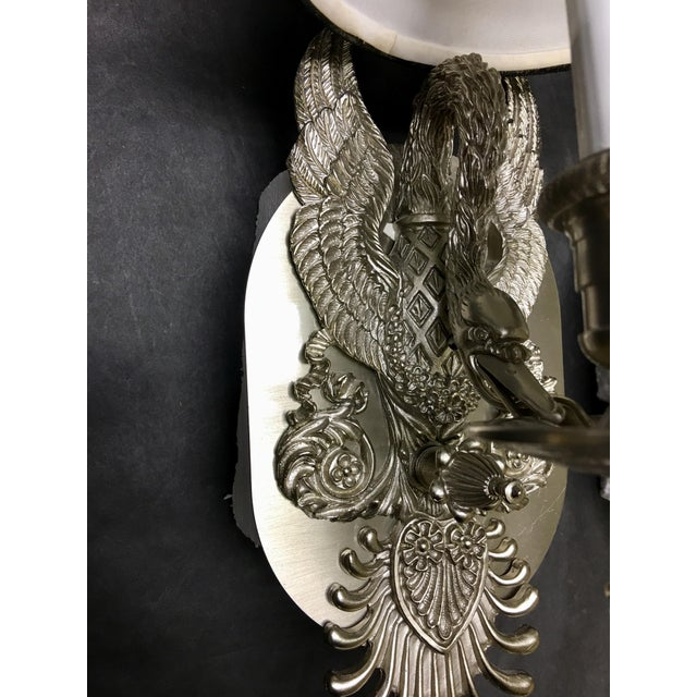 These pewter swan wall sconces are reproductions of a c.1930 silver pair. The swans mount on a backplate and have black...