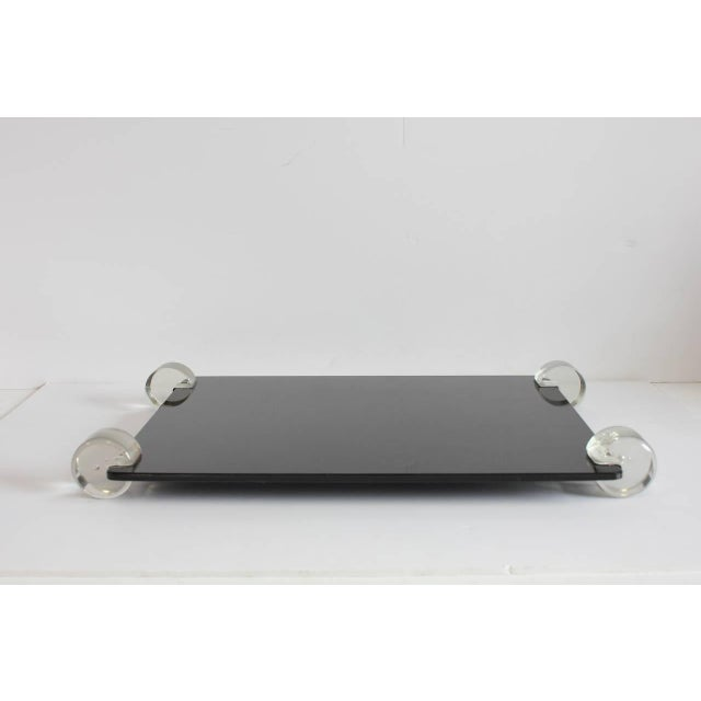 Mid-Century black glass and Lucite tray. Would look great with a modern vase and rose on it.