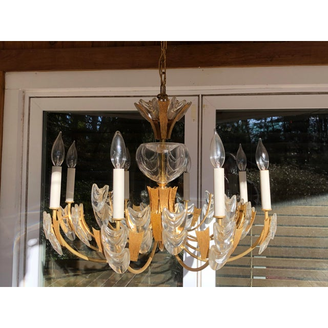 For sale is this beautiful gold plated 24k brutalist and Austrian glass 1960s chandelier. Designed by Palwa, Germany...