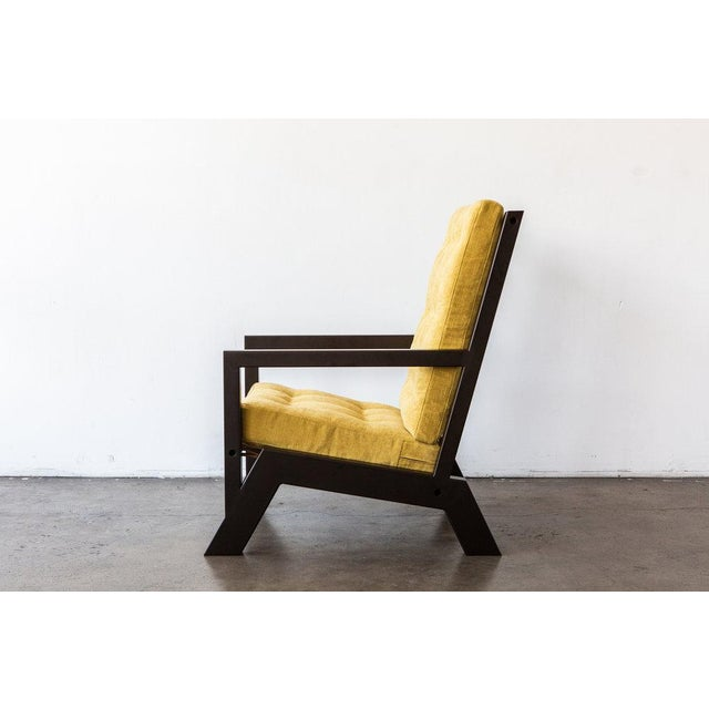 This lounge chair's design is inspired by the shape and feel of an old-school wingback armchair and the furniture of Frank...