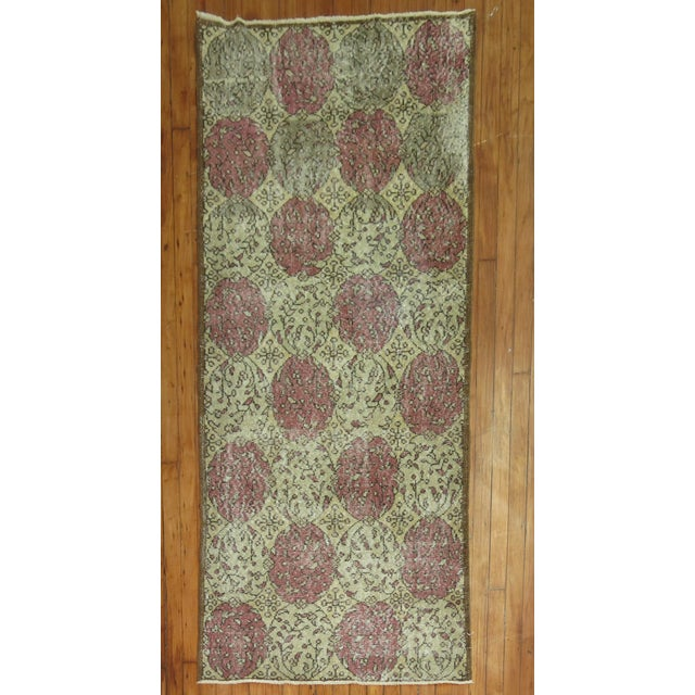 Offered is a lovely vintage Turkish runner. The distressed look over its ornate design gives this piece tons of...