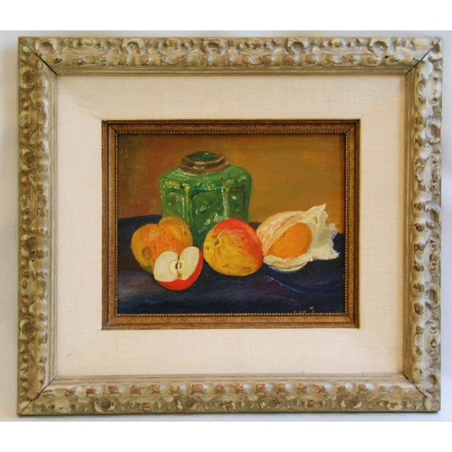 1960s oil painting on artist canvas panel depicting a wonderful fruit still life tablescape. Displayed in a period wood...