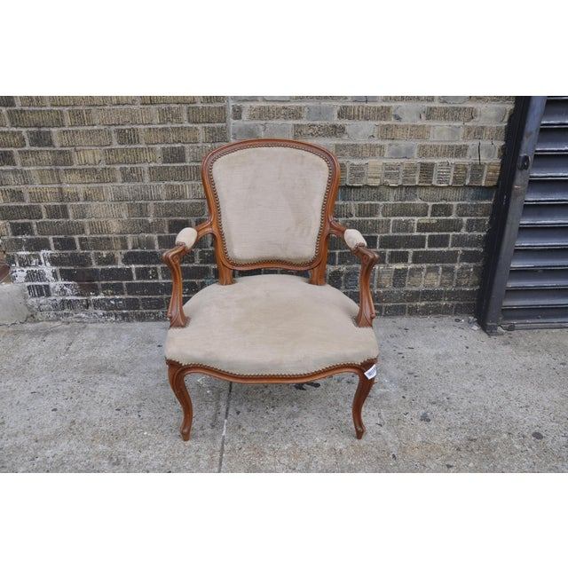 Gorgeous vintage reproduction Louis XV Roco style armchair upholstered in cloudy taupe velvet. Solid, sturdy and...