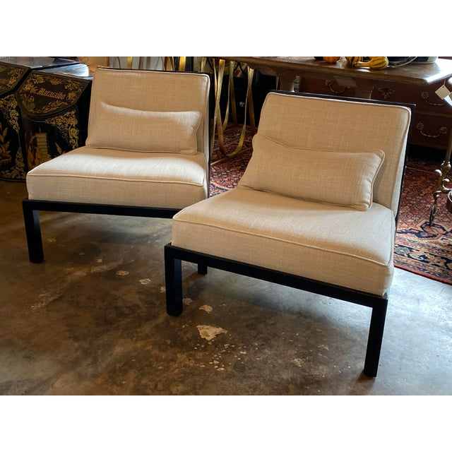 This comfortable pair of mid century asian modern black slipper chairs are by Michael Taylor for Baker. The back is...
