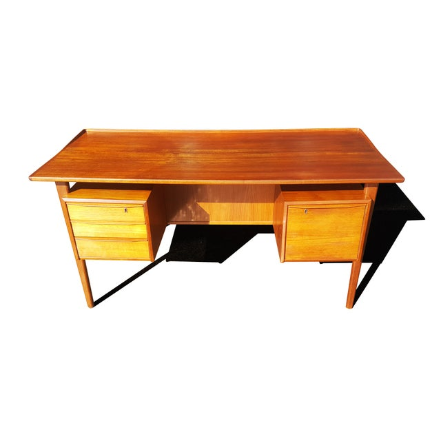 Designed by Peter Lovig-Nielsen during in 1963 and was manufactured by Hedensted Mobelfabrik in Denmark. Solid and veneer...