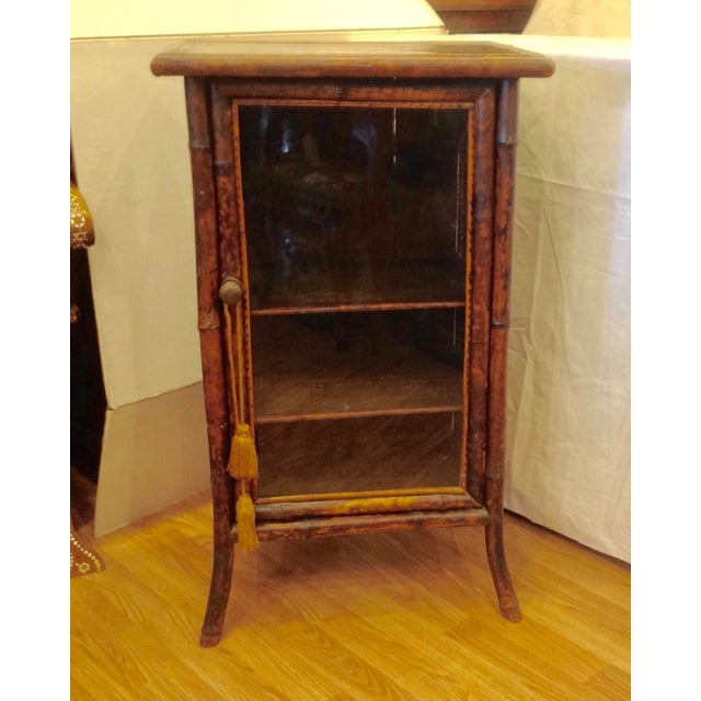 Neat size - fashioned originally for books or sheet music. Sides are wood.